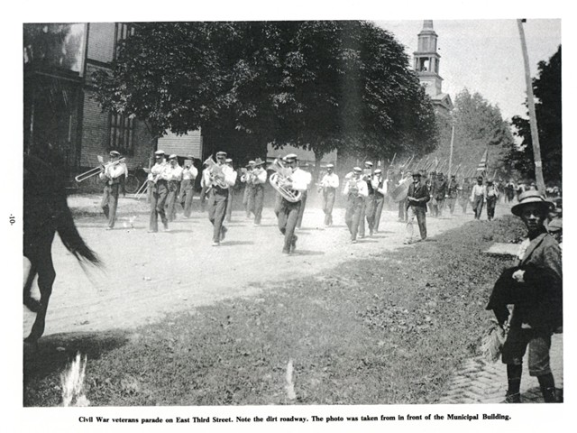 Civil War Veterans parade on East Third Stree. Note the dirt roadway. The photo was taken from in front of the Municipal Building.